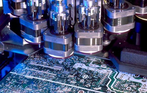 Inside a pick and place surface mount technology device
