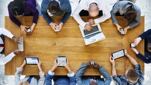 Team Meeting shown from above people using electronic devices
