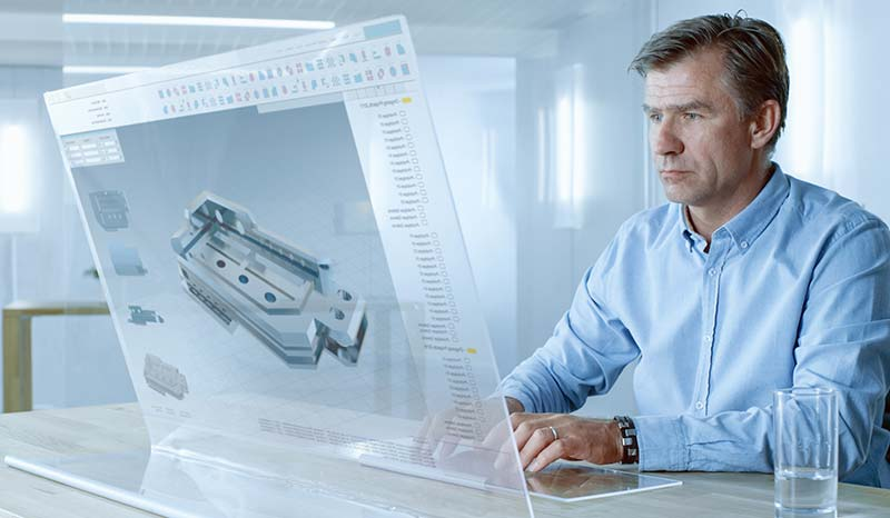 CAD operator reviewing a mechanical assembly for design for manufacture