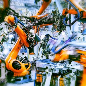 multiple assembly robots in action in an automotive factory